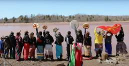Indigenous women looking out on a river